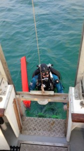 Diver stepping onto the dive lift